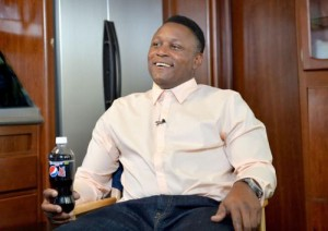 Barry Sanders smiles, perhaps thinking about how he could probably still win the NFL rushing title.